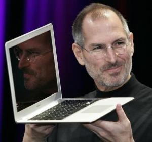 Apple CEO and co-founder Steve Jobs shows off the new Macbook Air ultra portable laptop during his keynote speech at Macworld.